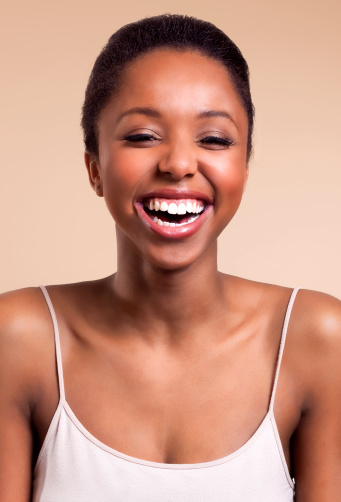 Beautiful African woman laughing and smiling